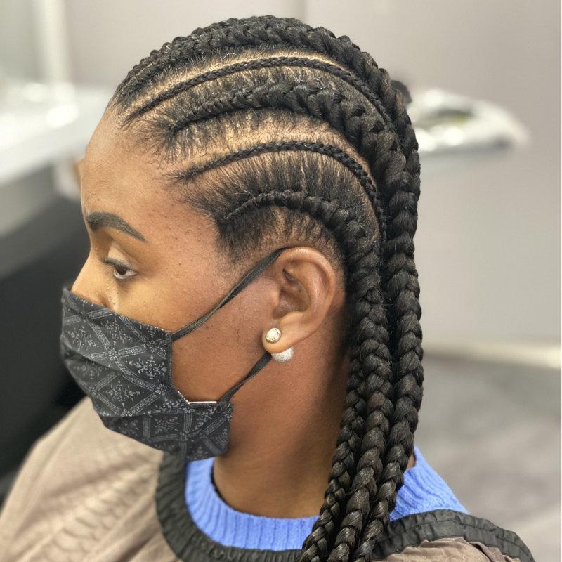 Nattes réalisée par Goldfingers Coiffure genève spécialiste en coiffures africaines